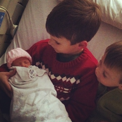 Meeting his baby sister