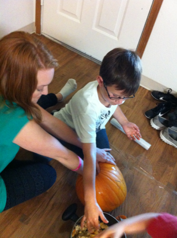 Clearing out pumpkin guts!